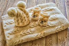 Baby clothes. On a vintage wooden table stock photos