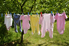Baby clothes on the washing line Royalty Free Stock Photo