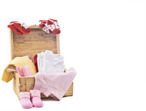 Baby clothes on wood box. Isolated on white Stock Images