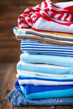 Baby clothes on a wooden table Royalty Free Stock Image