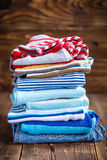 Baby clothes on a wooden table Stock Photos