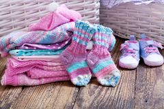 Baby clothes on wooden table. Various baby clothes on wooden table royalty free stock photography