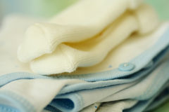 Baby clothing. A macro shot of baby clothing and socks Royalty Free Stock Image