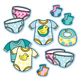 Baby clothing and accessories onesies diapers bib socks Royalty Free Stock Image
