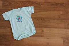 Baby clothing. Baby clothes and accessories in wood Royalty Free Stock Photos