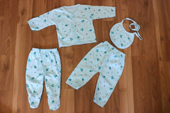 Baby clothing. Baby clothes and accessories in wood Royalty Free Stock Photography