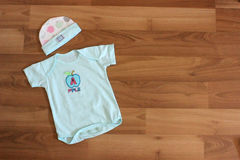 Baby clothing. Baby clothes and accessories in wood Stock Image