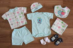 Baby clothing. Baby clothes and accessories in wood Stock Images