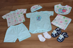 Baby clothing. Baby clothes and accessories in wood Stock Photos