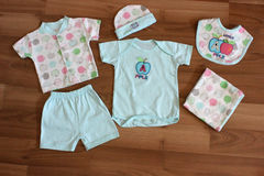 Baby clothing. Baby clothes and accessories in wood Royalty Free Stock Photo