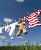 Baby clothing on a clothesline Stock Images
