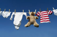 Baby clothing on a clothesline Royalty Free Stock Images