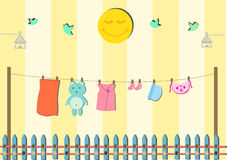 Baby clothing on clothespin Stock Image