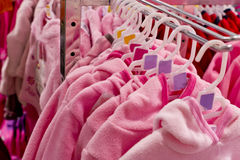 Baby clothing on hangers Stock Image