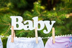 Baby clothing hanging on the clothesline Stock Photo