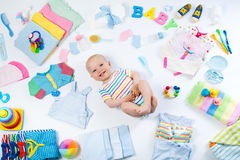 Baby with clothing and infant care items Royalty Free Stock Image