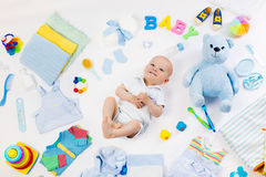 Baby with clothing and infant care items Royalty Free Stock Photo
