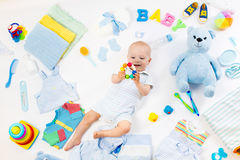 Baby with clothing and infant care items Royalty Free Stock Photography