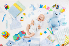 Baby with clothing and infant care items. Baby on white background with clothing, toiletries, toys and health care accessories. Wish list or shopping overview Stock Image