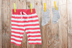 Baby clothing. On a wood background Stock Photography