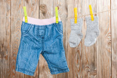 Baby clothing. On a wood background Stock Images