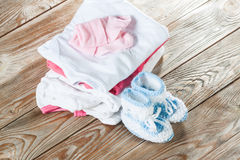 Baby clothing. On a wood background Stock Image