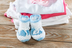 Baby clothing. On a wood background Stock Photo