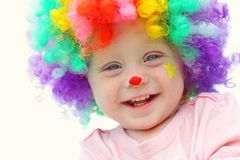Baby in Clown Costume Stock Photo