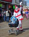 Baby Clown with Daddy Clown. Baby clown with daddy clown during parade on boardwalk at Seaside shore during Clownfest. Taken September 14, 2014 Royalty Free Stock Photos