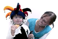Baby in clown hat with mom Stock Image