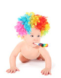 Baby clown with mulicolored wig and party blower Royalty Free Stock Image