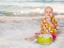 Baby with coconut Stock Image
