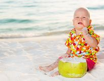 Baby with coconut Stock Photography