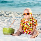 Baby with coconut Royalty Free Stock Images