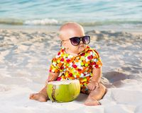 Baby with coconut Stock Photos