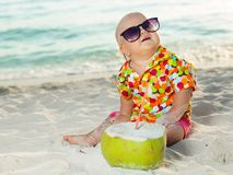 Baby with coconut Royalty Free Stock Photos
