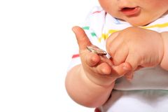 Baby and coin. Royalty Free Stock Images