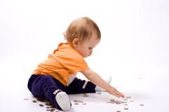 Baby and coins Royalty Free Stock Photography