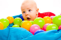 Baby with colorful balls Stock Photos
