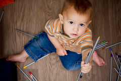 Baby with colorful pencils Stock Photo