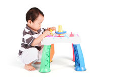 Baby with colorful toy. Portrait of baby playing with colorful toy, isolated on white background Stock Photography
