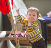 Baby Coloring on Easel Royalty Free Stock Images