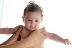 Baby in the comfort of moms hands Stock Photography
