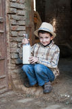 Baby coming out of the barn with fresh milk Stock Images