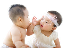 Baby communication. Two Asian babies having baby talk royalty free stock image