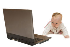 Baby and computer Royalty Free Stock Photography