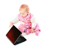 Baby with computer Royalty Free Stock Image