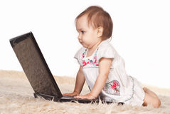 Baby with computer Royalty Free Stock Photography