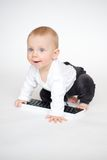 Baby on computer keyboard Stock Photo