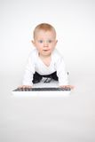 Baby with computer keyboard Royalty Free Stock Images